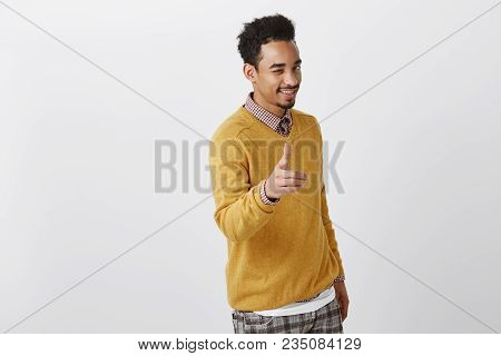 Picking You To Be Partner In Crime. Studio Shot Of Charming Emotive African-american Male With Afro