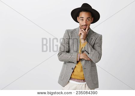 Designer Looks At Model In His Clothes. Portrait Of Classy Handsome Young Man In Stylish Formal Outf