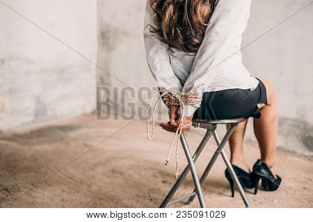 Woman Hands Bound. Women Were Handcuffed And Sitting On A Chair.woman Tied Hand To A Chair.crime Con
