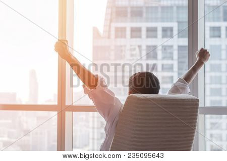 Business Achievement Concept With Happy  Businessman Relaxing At Work In Office Room, Resting And Ra