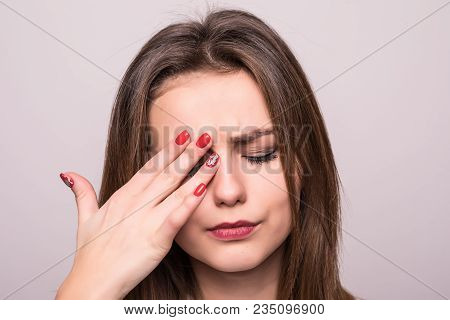 Pain. Tired Exhausted Stressed Woman Suffering From Strong Eye Pain. Portrait Of Beautiful Young Fem