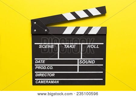 Movie Clapper On Yellow Background; Film, Cinema And Video Photography Concept