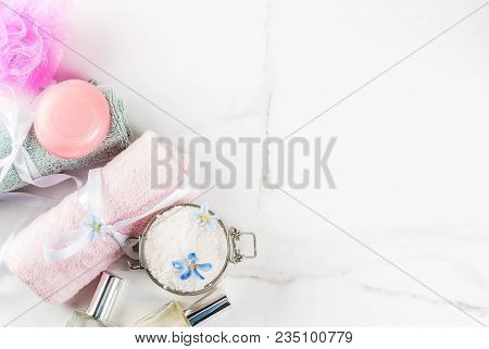 Spa Relax And Bath Concept, Sea Salt, Soap, With Cosmetics And Towels In Bathroom White Background,
