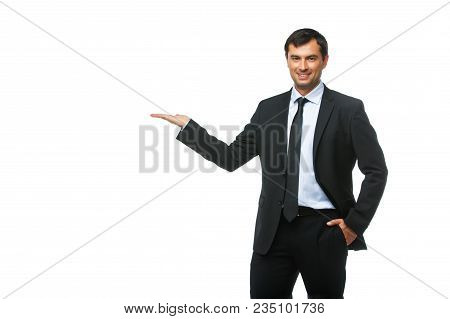 Handsome Young Businessman In Business Sut, Blue Shirt And Tie. Happy Expression. Studio Shot Isolat