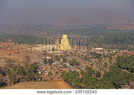 Virupaksha Temple. View from the Matanga hill to the Virupaksha temple and bazaar village Hampi. Panoramic view from above, aerophoto. poster