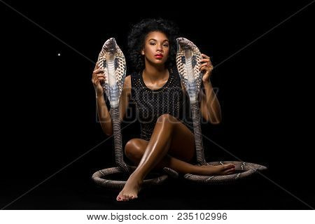Beautiful Dark Skin Young Woman With Snakes. Exotic Beauty. Studio Shot On Black Background. Copy Sp