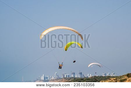 Paragliding Over Mediterranean Sea And Arsuf Beach. Israel