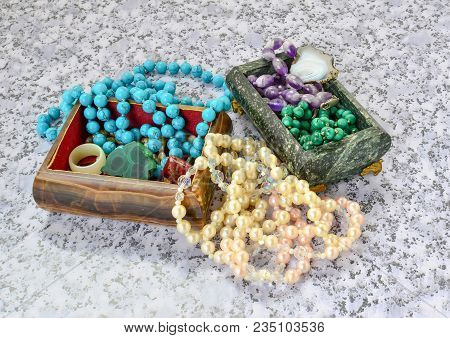 Caskets From Onyx And Serpentine With A Beads From Turquoise, Malachite, Pearls, Amethyst Close Up.
