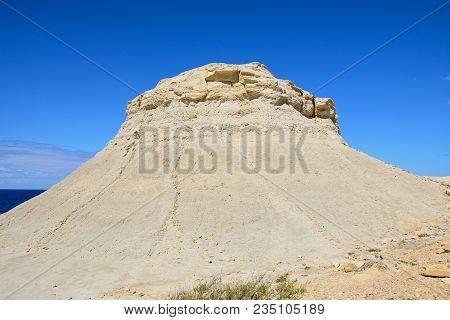 Limestone Mound Along The Coastline, Redoubt, Marsalforn, Gozo, Malta, Europe.
