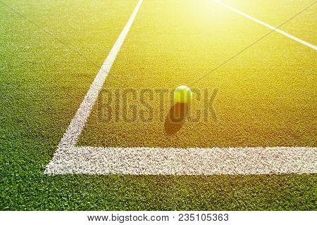 Soft Focus Of Tennis Ball On Tennis Grass Court Good For Background With Sun Light