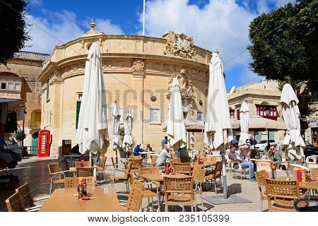 Victoria, Gozo, Malta - April 3, 2017 - Pavement Cafes In Independence Square With The Council Offic