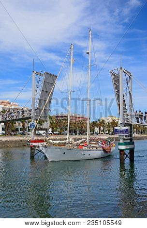 Lagos, Portugal - June 9, 2017 - Yacht Passing Through The Open Bascule Footbridge Along The River B