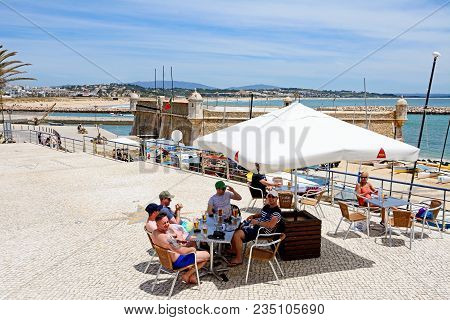 Lagos, Portugal - June 9, 2017 - Elevated View Of The Ponta Da Bandeira Fort With Tourists Relaxing