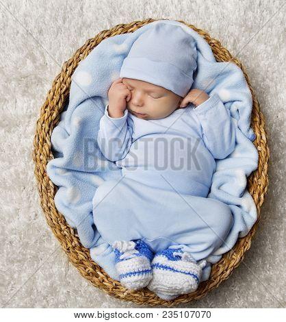 Baby Newborn Sleep In Basket, New Born Child Sleeping In Blue Bodysuit, Asleep Infant Kid