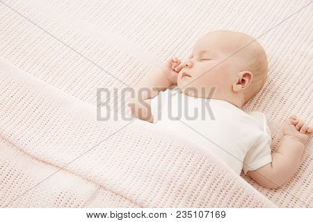 Baby Girl Sleep In Bed, New Born Child Covered By Pink Knitted Blanket, Sleeping Newborn Kid