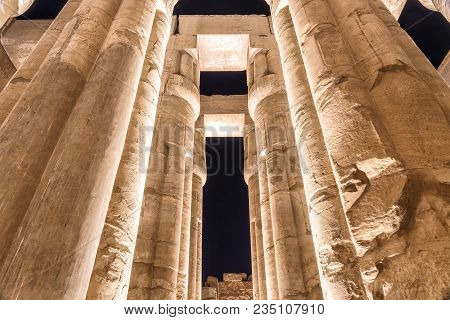 Luxor Temple Lit Up At Night, Besides The River Nile In Luxor, Egypt.