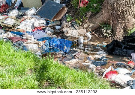 Garbage. Big Pile Of Garbage And Junk In The River Water Polluting The Nature With Litter