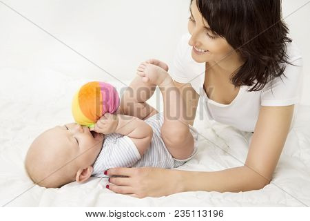 Mother And Baby Playing Toy Ball, New Born Kid Play With Mom, Happy Family On White Background