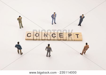 Miniature Figures Businessman : Meeting On Concept  Word By Wooden Block Word On White Paper Backgro