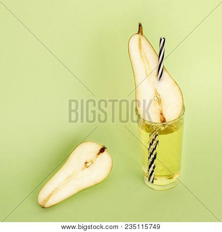 Light Pear Lemonade In A Transparent Glass Cup And With A Straw Striped Across The Pear And Half Of