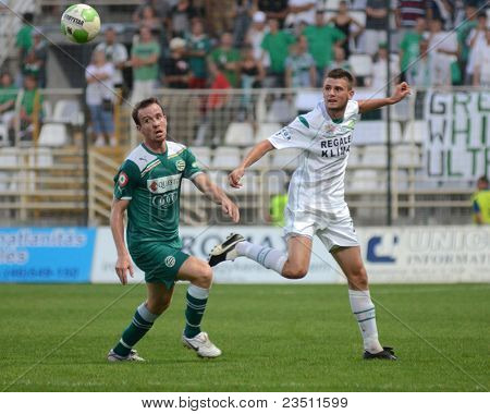 KAPOSVAR, HUNGARY - SEPTEMBER 10: Unidentified players in action at a Hungarian National Championship soccer game - Kaposvar (white) vs Gyor (green) on September 10, 2011 in Kaposvar, Hungary.