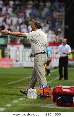 KAPOSVAR, HUNGARY - SEPTEMBER 10: Aurel Csertoi (Gyor trainer) at a Hungarian National Championship soccer game - Kaposvar (white) vs Gyor (green) on September 10, 2011 in Kaposvar, Hungary.