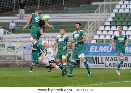 KAPOSVAR, HUNGARY - SEPTEMBER 10: Zoltan Feher (green 6) in action at a Hungarian National Championship soccer game - Kaposvar (white) vs Gyor (green) on September 10, 2011 in Kaposvar, Hungary.