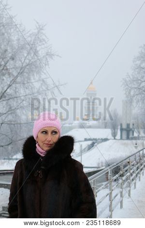 A Woman On The Winter Bridge Looks Mysteriously To The Left. Enigmatic Glance Of Middle-aged Woman W