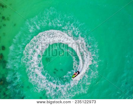 People Are Playing Jet Ski At Sea During The Holidays.aerial View And Top View.