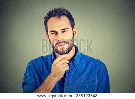 Suspicious Skeptical Young Man Looking At Camera