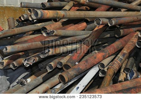 Metal Pipes Stacked For Scrap, Junk, Background