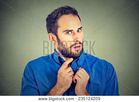 Suspicious Worried Young Man Looking Anxiously At Camera