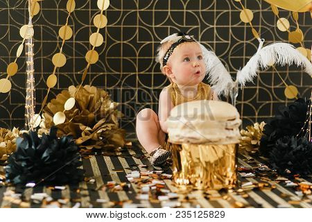 Happy Infant Baby Girl Celebrating Her First Birthday. Cake Smash On Black Backround With Golden Dec
