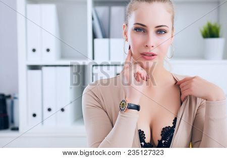 Sexy secretary undress in office, flirt and desire poster