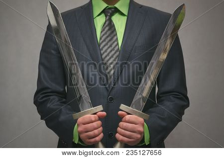 Businessman Holds In Hand A Toy Sword Weapon. Life Or Finance Insurance Agent. Money Deposite Safety