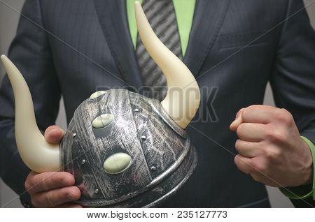 Bull Stock Broker. Bull Market Concept. Agressive Business Strategy. Business Man Holding A Toy Viki