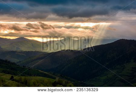 Beams Of Light Over The Mountains. Beautiful Landscape In Stormy Weather