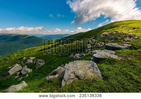 Row Of Huge Rocks On A Grassy Mountain. Lovely Summer Scenery Of Carpathian Mountains. Cloud Approac