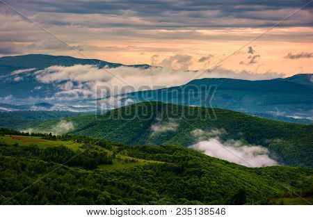 Rising Clouds Above The Mountain Ridge. Gorgeous Springtime Scenery At Sunrise