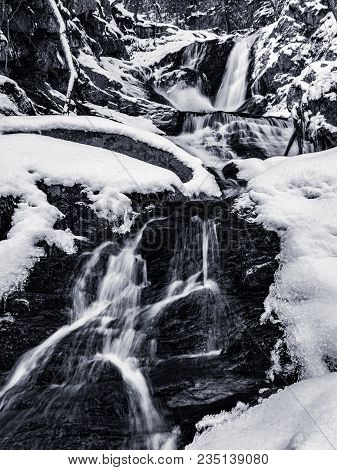 Winter Time Hiking To The Sanderson Brook Falls In Chester Ma.  Snow And Ice Cover The Landscape In