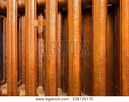 Bars Of Old Copper Heating Radiator