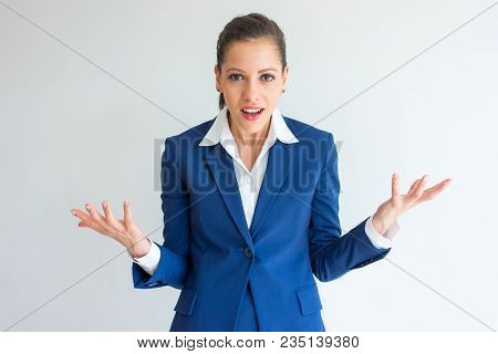 Shocked Business Woman With Questioning Face Spreading Hands. Angry Manager Surprised And Concerned.