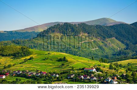 Rural Area In Mountains At Sunset. Lovely Summer Landscape Of Volovets Town, Ukraine. Mountain Velyk