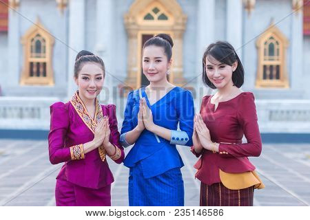 Beautiful Thai Girl In Thai Costume,asian Woman Wearing Traditional Thai Culture Standing In Front A