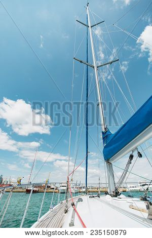 Sailing Boat Deck On A White Yacht With Lowered Sails And Teak Wooden Deck, Metal Railing, Set Of Re