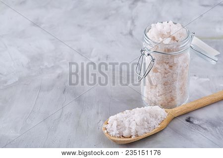 Large White Sea Salt Crystals In A Natural Wooden Bowl On White Textured Background, Top View, Close