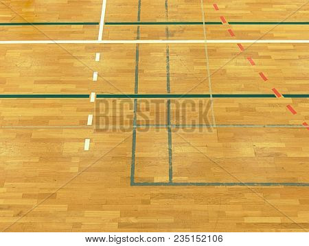 White, Black Red Lines, Green Playfield In Sporting Hall. Renewal Wooden Floor Of Sports Hall With C