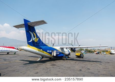 KATHMANDU, NEPAL - CIRCA MARCH 2108: A Buddha Air ATR 42 parked at Tribhuvan International Airport.