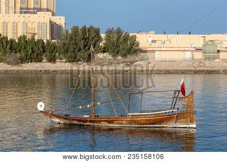 DOHA, QATAR - April 7, 2018: A small traditioonal Arab boat moored in the museum lagoon in Doha, Qatar.