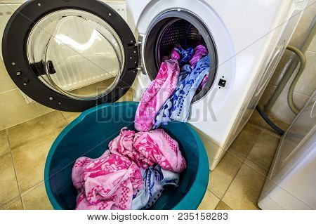 Colorful Clothes And Towels In Washing Machine Drum